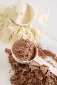 chocolate and vanilla protein powder scoops