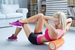 woman foam rolling back